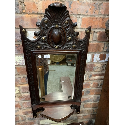 262 - AN ORNATE WOODEN WALL MIRROR...