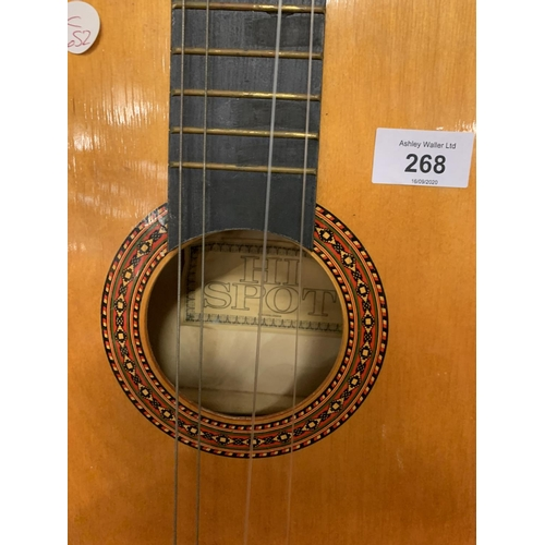 268 - A HI SPOT ACOUSTIC GUITAR WITH COLOURED STRAP...