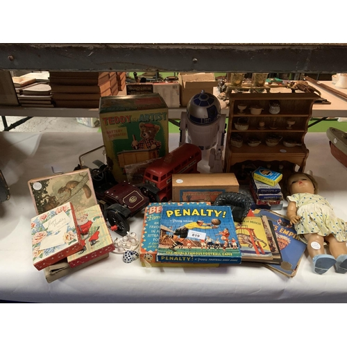 819 - A COLLECTION OF VINTAGE BOOKS AND GAMES TO INCLUDE DOLLS DRESSER, BATTERY OPERATED TEDDY ARTIST AND ...