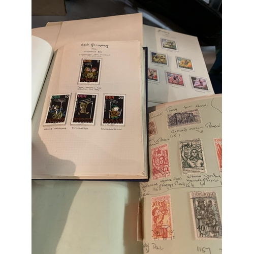 857A - THREE ALBUMS CONTAINING VARIOUS THEMED STAMPS...