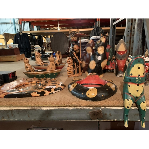 884 - A COLLECTION OF HAND CARVED AND PAINTED CATS ETC...