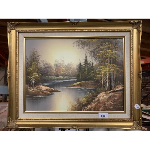 896 - A GILT FRAMED PRINT OF A RIVER IN A FOREST...