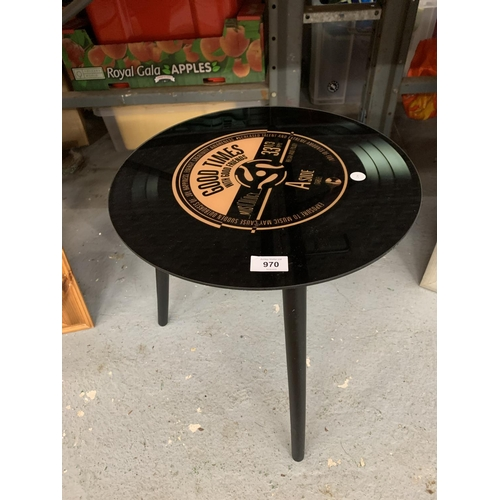 970 - A RETRO THREE LEGGED TABLE WITH A RECORD TOP...