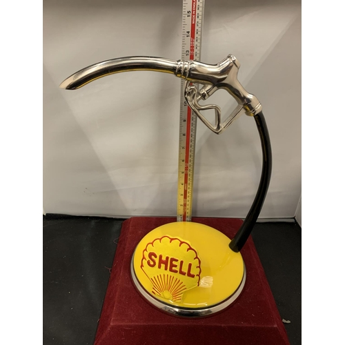 67 - A SHELL PETROL PUMP HANDLE ADVERTISING SIGN ON A BASE...