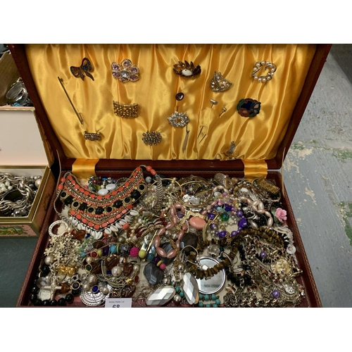 68 - A LARGE ASSORTMENT OF COSTUME JEWELLERY TO INCLUDE TO CASES...