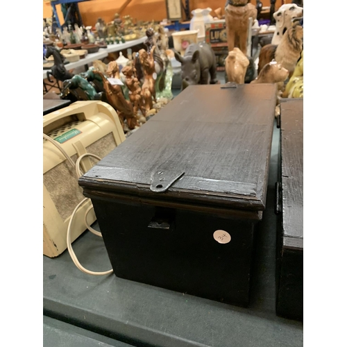 92 - A PAIR OF BLACK WOODEN DEED BOXES...