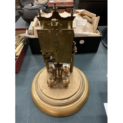106 - A CARRIAGE CLOCK MOVEMENT TO INCLUDE FACE AND WEIGHTS...