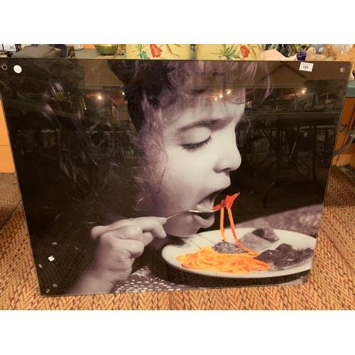 199 - LARGE LAMINATED IMAGE OF GIRL EATING SPAGHETTI...