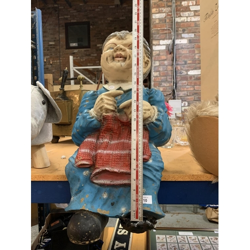 210 - A LARGE RESIN LADY WITH A KNITTED JUMPER TO SIT ON A SHELF (A/F)...