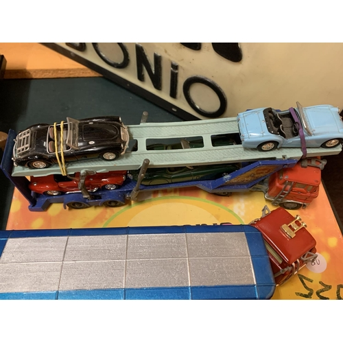 214 - TWO UNBOXED CORGI DIE CAST VEHICLES TO INCLUDE A FORD EXPRESS SERVICE LORRY AND A FORD CARRIMORE WIT...