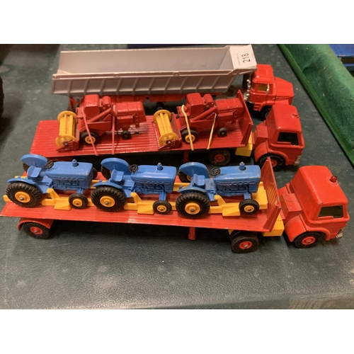 218 - THREE ARTICULATED LORRIES, TO INCLUDE TWO TRANSPORTERS WITH THREE FORD TRACTORS AND TWO COMBINE HARV...