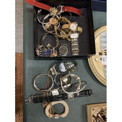 246 - A BOX CONTAINING VARIOUS WRIST WATCHES TO ALSO INCLUDE A FOB WATCH ON A CHAIN
