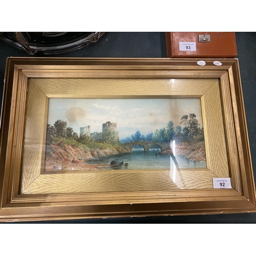 92 - A FRAMED WATERCOLOUR OF A CASTLE AND RIVER SCENE...