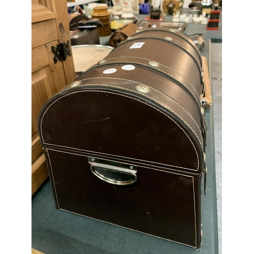 95 - A LEATHER EFFECT DOMED CARRY CASE...
