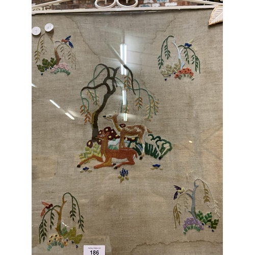 186 - AN ORNATE VINTAGE FIRESCREEN DEPICTING VARIOUS ANIMALS...