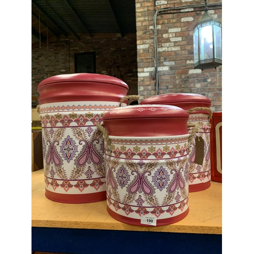 190 - A SET OF THREE VARIOUS SIZED DECORATIVE PINK LAUNDRY/STORAGE BINS...
