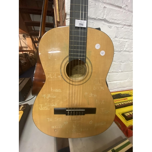 286 - A BURSWOOD ACOUSTIC GUITAR WITH CANVAS CARRY CASE...