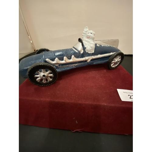 23 - A VINTAGE CAST MICHELIN MAN IN BLUE RACING CAR...