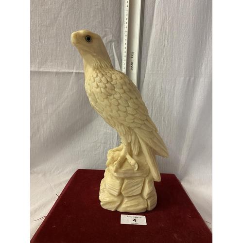 4 - A RESIN FIGURE OF A BIRD OF PREY - HEIGHT 28CMS