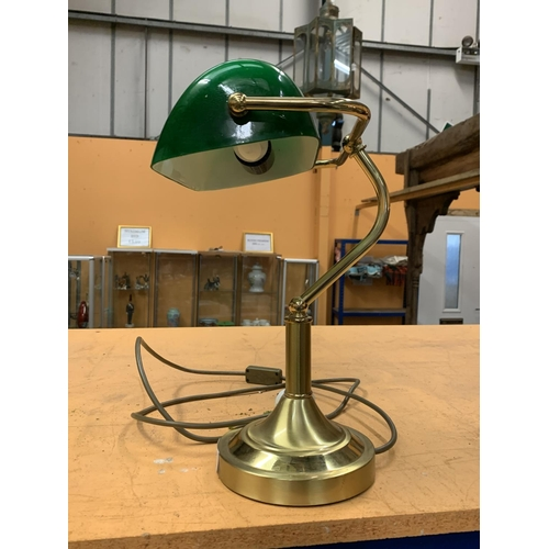 38 - A BRASS BANKERS LAMP WITH GREEN SHADE