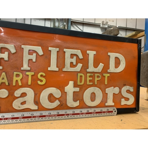 39 - AN ILLUMINATED 'NUFFIELD PARTS DEPT TRACTORS' SIGN...