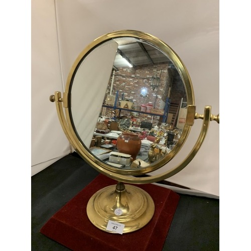 47 - A BRASS 19TH CENTURY STYLE SWING VANITY MIRROR ON A PEDESTAL BASE...