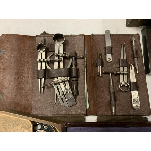 12 - A LARGE COLLECTION OF VINTAGE COMPASSES, TECHNICAL DRAWING INSTRUMENTS AND CALIPERS TO INCLUDING A M...