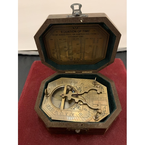 22 - A BOXED BRASS SUNDIAL COMPASS 'COX OF LONDON'...