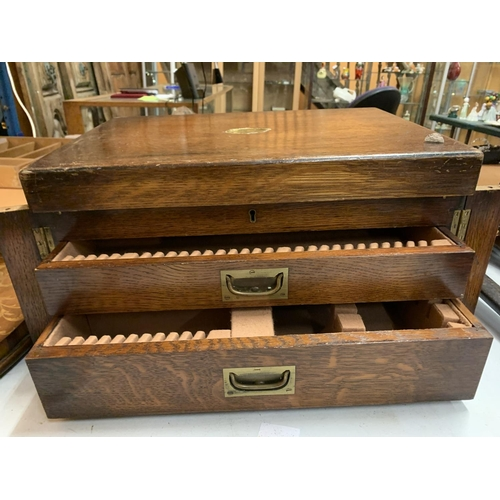 25 - A LARGE WOODEN FLATWARE BOX WITH TWO DRAWERS AND HINGED LID WITH BRASS DETAIL