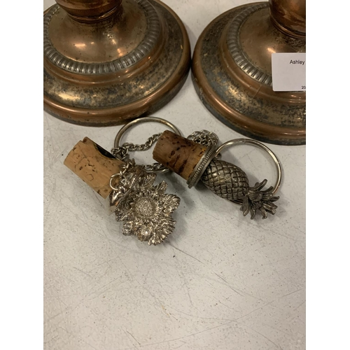 5 - A PAIR OF VINTAGE SILVER PLATED ON COPPER CANDLESTICKS - HEIGHT 21CMS AND TWO WHITE METAL BOTTLE STO...