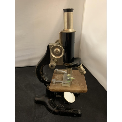 13 - A VINTAGE 'PRIOR LONDON' MICROSCOPE TO INCLUDE A BOX OF VINTAGE SLIDES
