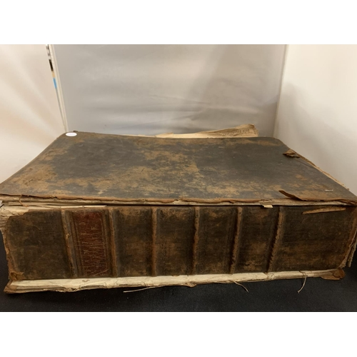 20 - A LARGE HEAVY VINTAGE FAMILY BIBLE (42X30X10CM) - SPINE REQUIRES REPAIR