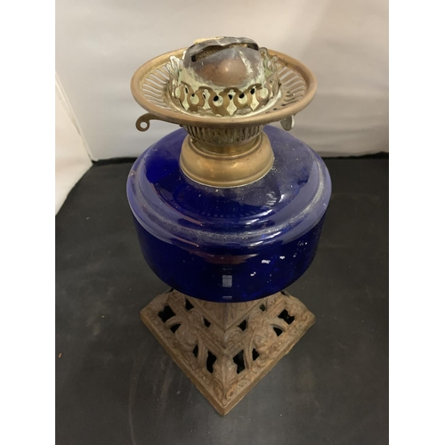 21 - A BLUE GLASS OIL LAMP BASE WITH DECORATIVE BRASS DETAIL (H: 30CM)