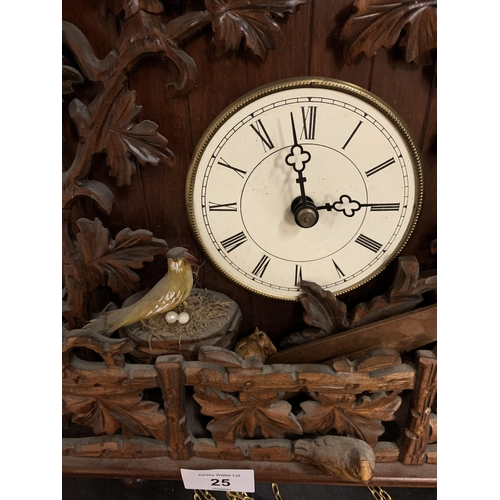 25 - A VERY LARGE EXAMPLE OF A WOODEN HEAVILY CARVED CUCKOO CLOCK TO INCLUDE WEIGHTS (APPROXIMATELY 40X48...