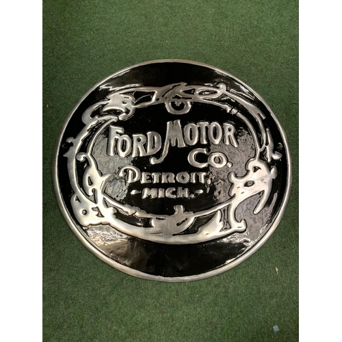 35 - A 'FORD MOTOR COMPANY' BLACK AND SILVER METAL SIGN (D: 49.5CM)