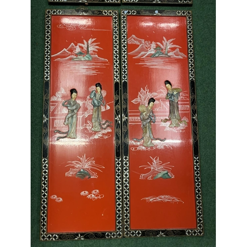 36 - FOUR CHINESE DECORATIVE RED PLAQUES WITH ORIENTAL FIGURES IN RELIEF (APPROXIMATELY 91X30CM)