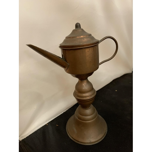 45 - A LARGE CAST METAL CAMEL AND A MIDDLE EASTERN STYLE COFFEE POT