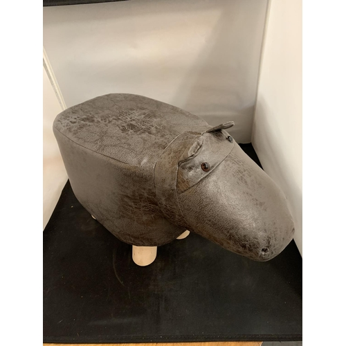 47 - A FAUX LEATHER CHILD'S FOOTSTOOL IN THE FORM OF A HIPPOPOTAMUS
