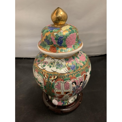53 - A LARGE 1970s CHINESE CANTON FAMILLE ROSE FIGURAL GINGER JAR ON A WOODEN STAND
