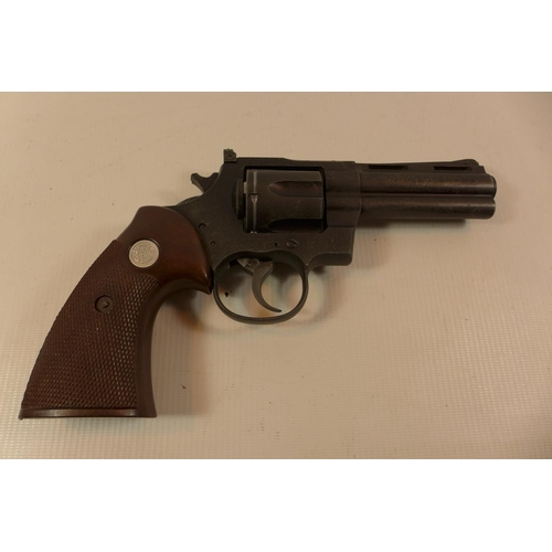 311 - A REPLICA NON FIRING SMITH AND WESSON PYTHON 357 MAGNUM REVOLVER WITH A 10CM BARREL AND HAMMER A/F