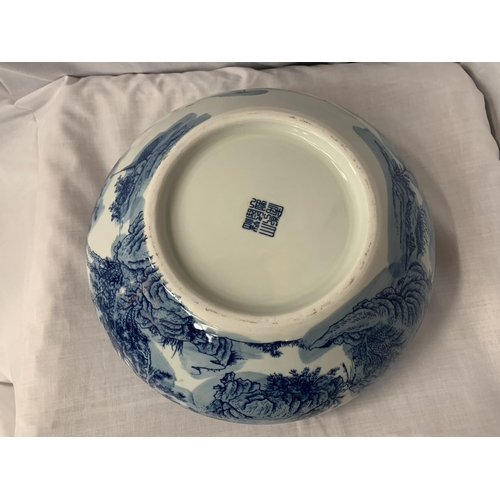 3 - A LARGE HEAVY BLUE AND WHITE CERAMIC BOWL WITH ORIENTAL DECORATION DIA: 32CM