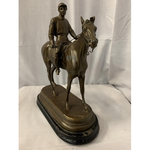 31 - A SPELTER FIGURINE IN THE FORM OF A HORSE AND JOCKEY SIGNED C VALTON