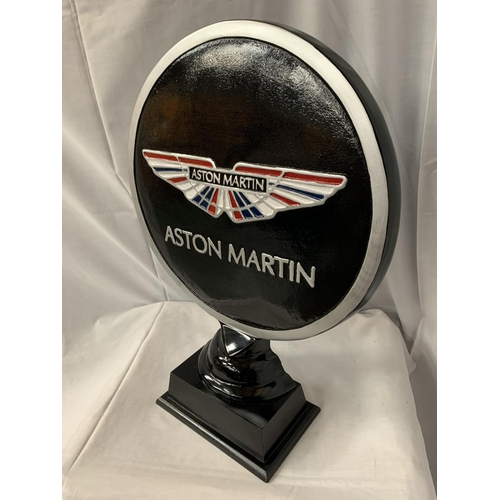 36 - A LARGE ASTON MARTIN SIGN ON A WOODEN PLINTH H: APPROXIMATELY 52CM