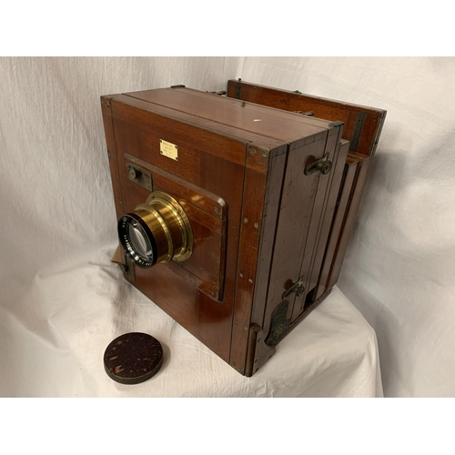 46 - A LARGE MAHOGANY PENROSE & CO VINTAGE CAMERA WITH BRASS DETAIL 31CM X 35CM X 29CM