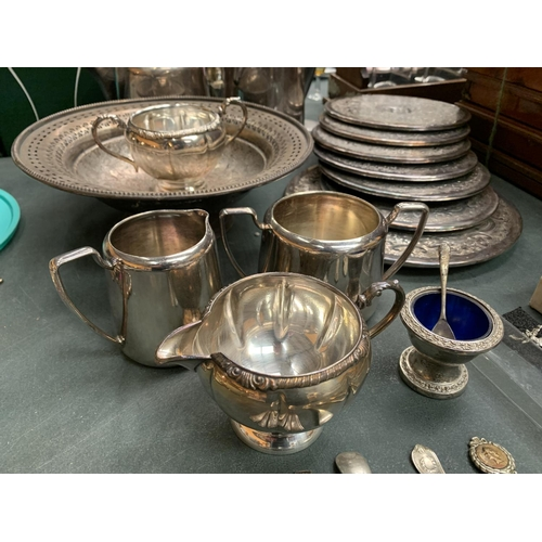 48 - A LARGE QUANTITY OF SILVER PLATE ITEMS TO INCLUDE A COMPORT, FLATWARE, PLACE MATS ETC