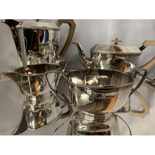 26A - A LARGE SILVERPLATE TRAY WITH TWO SILVERPLATE TEA POTS, MILK AND CREAMER JUGS AND SUGAR BOWL