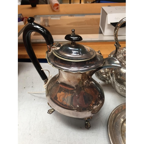 17 - A SELECTION OF SILVER PLATED ITEMS TO INCLUDE TEA POTS, SUGAR BOWL AND TWO FURTHER ITEMS
