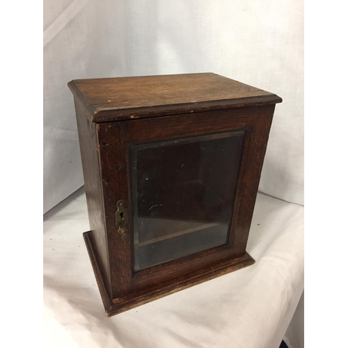 22 - AN MINATURE OAK GLASS FRONTED CABINET HEIGHT 25CM