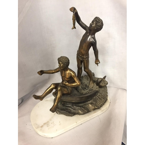 24 - A SCULPTURE OF TWO BOYS IN A ROWING BOAT ON A MARBLE BASE