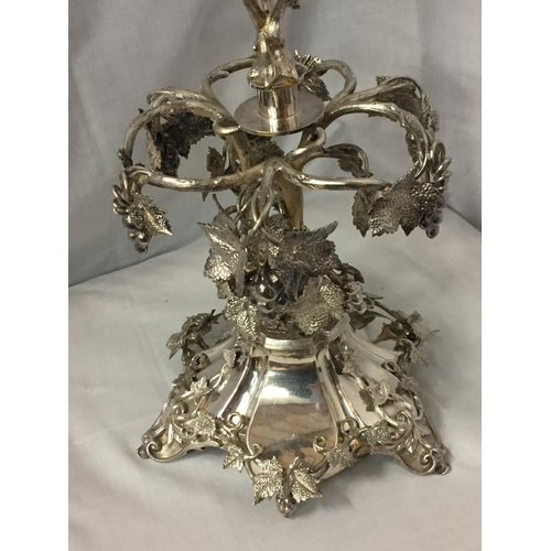 3 - AN ORNATE SILVER PLATED EPERGENE WITH GLASS FLUTE HEIGHT 65CM